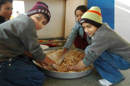 Children take responsibilities every week - in the kitchen at IWS Indore